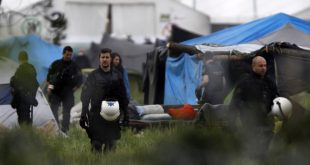 Greek policemen inspect the tents at a makeshift refugee camp at the Greek-Macedonian border near the northern village of Idomeni, Tuesday, May 24, 2016. Greek authorities have begun an operation to gradually evacuate the country's largest informal refugee camp of Idomeni, located on the Greek-Macedonian border, where more than an estimated 8,400 people have been living for months. (AP Photo/Boris Grdanoski)